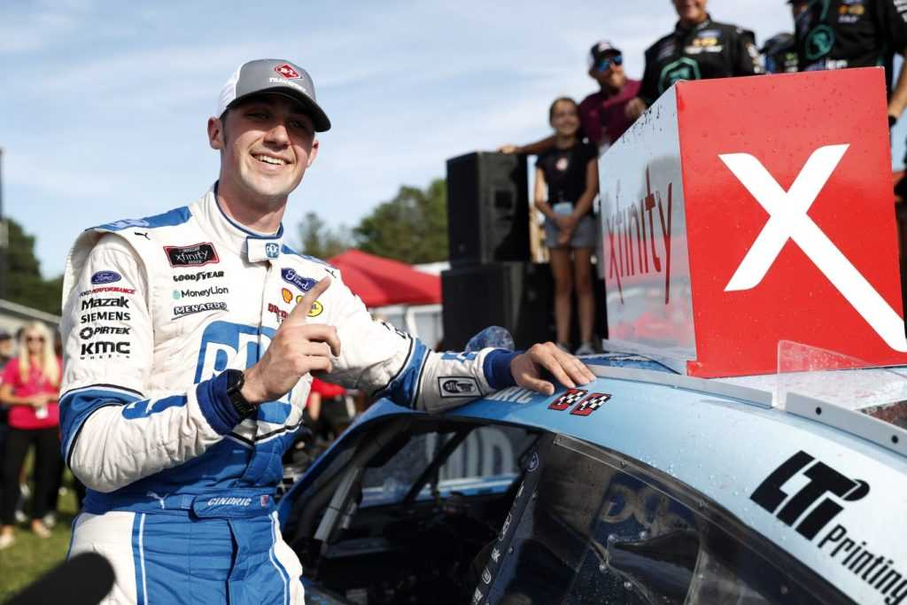 Austin Cindric, driver of the #22 PPG Ford, celebrates after winning the B&L Transport 170 at Mid-Ohio Sports Car Course on August 10, 2019