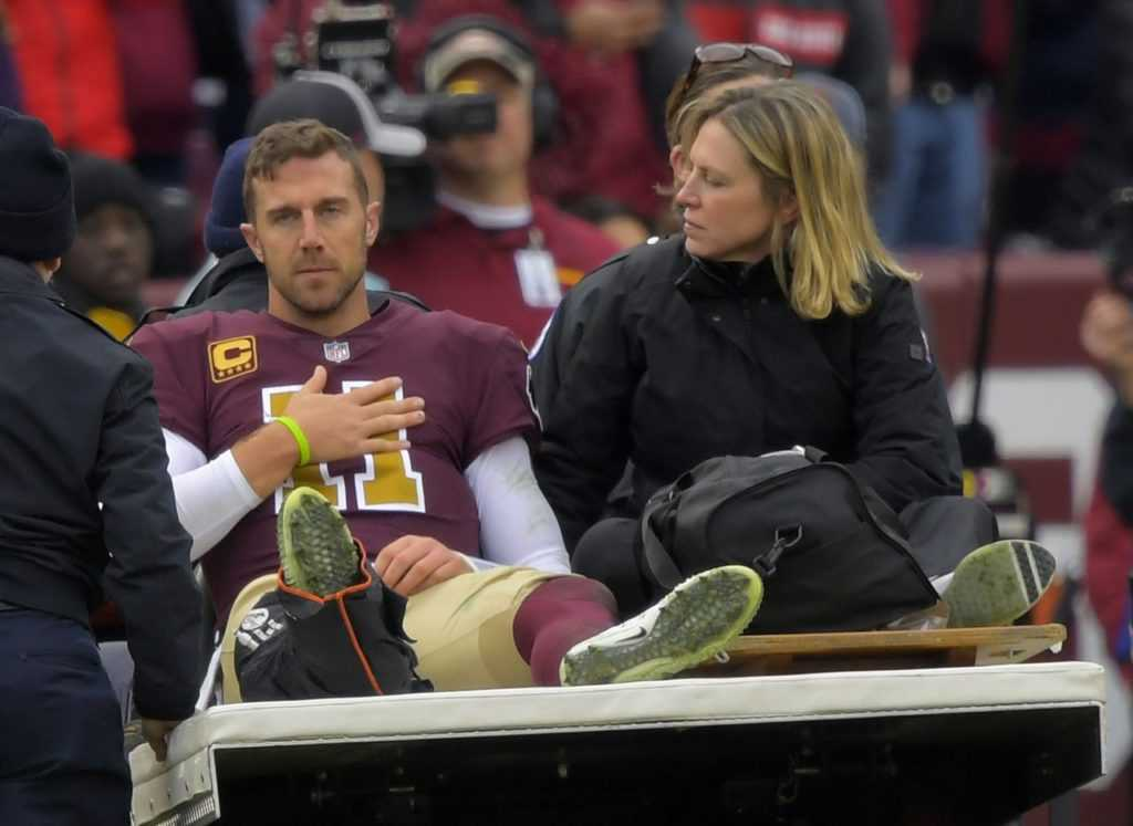 This image shows Alex  Smith getting carted off the field after breaking his right leg on November 18, 2018.  This injury factors in to Smiths current immobility.