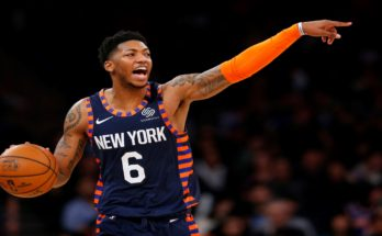 Elfrid Payton dribbles the ball up for the New York Knicks.