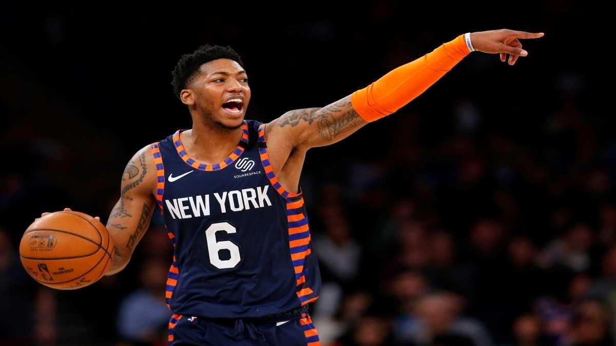 Elfrid Payton dribbles the ball up for the New York Knicks.