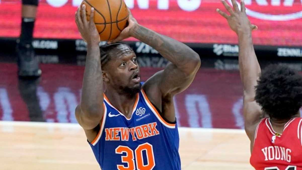 Julius Randle lets if fly from three for the Knicks.