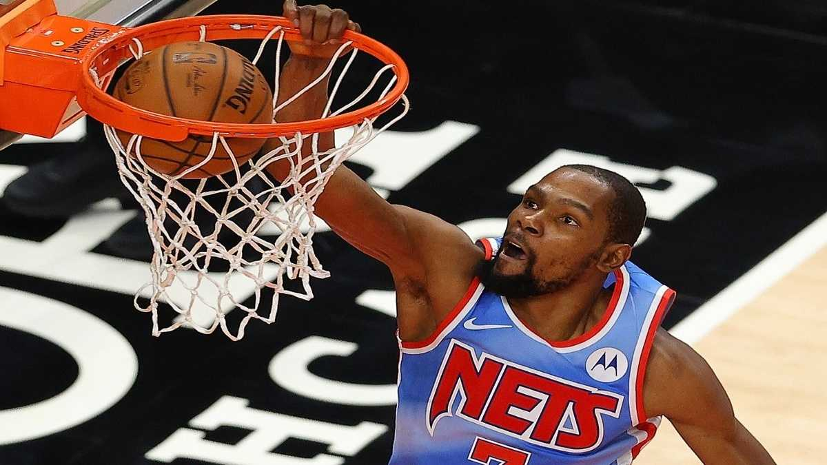 Kevin Durant finishing a dunk for the Brooklyn Nets.