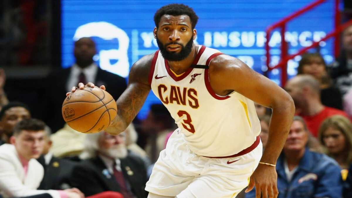 Andre Drummond dribbles the ball or the Cleveland Cavaliers.