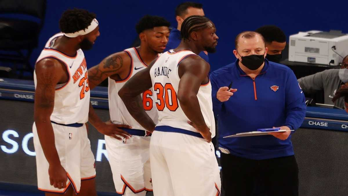 Tom Thibodeau talks it over with his team during a Knicks timeout.