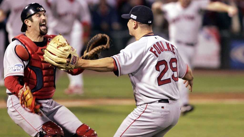 Varitek's legacy grows as he embraces Foulke after winning the 2004 World Series.