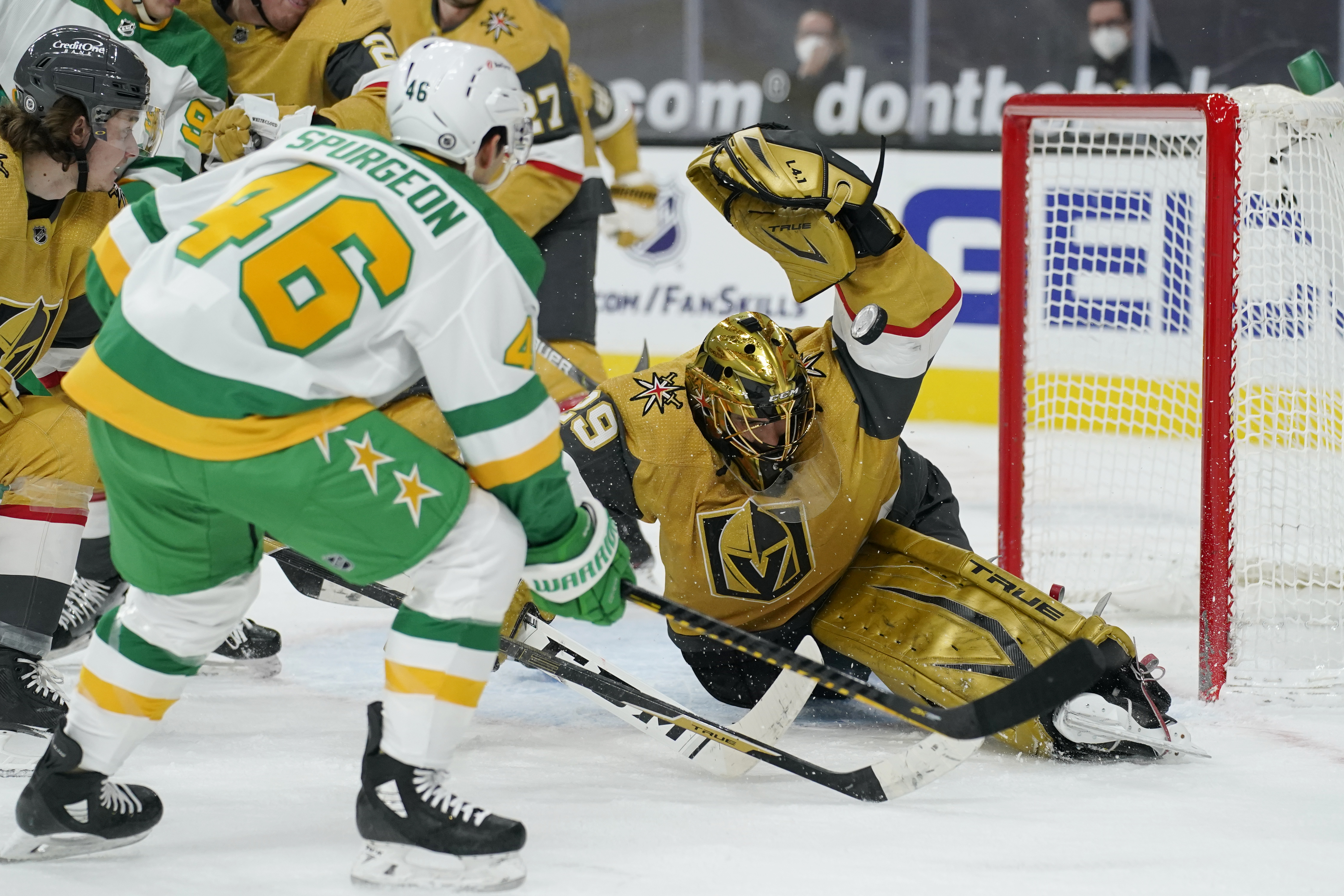 Marc-Andre Fleury making a save from Jared Spurgeon.