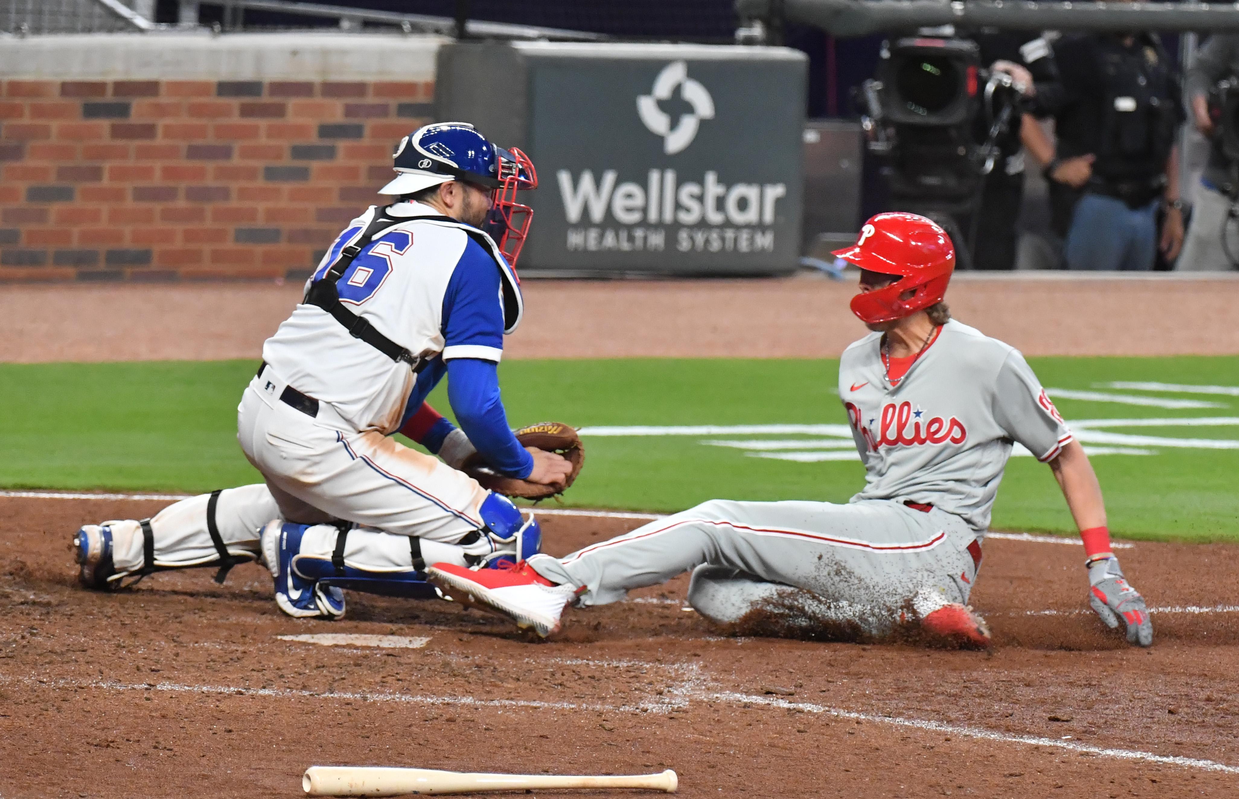 Alec Bohm called safe at home by MLB umpires on a bang-bang play.