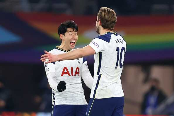 Tottenham players Harry Kane and Heung-min Son celebrate a goal.