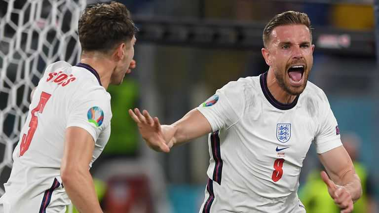 England players Henderson and Stones celebrate.