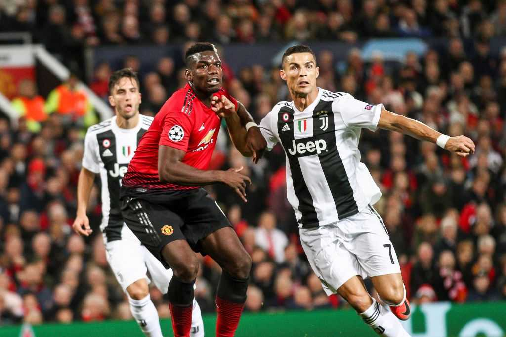 Cristiano Ronaldo battles against Paul Pogba in the Champions League.