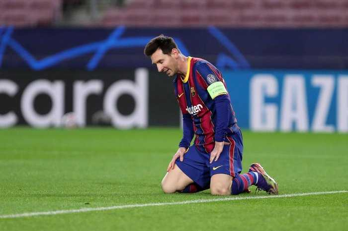 Lionel Messi looks on in disappointment in the Champions League.