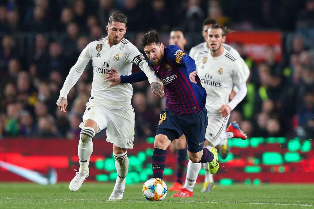Lionel Messi battles with Sergio Ramos in El Clásico.