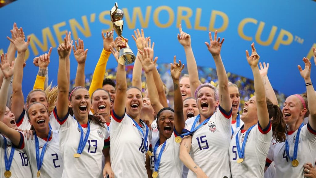 """The USWNT and its players celebrating winning the 2019 FIFA World Cup. """"pictured here"""""""