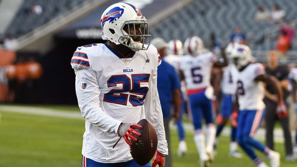 """LeSean McCoy walking with the football as a member of the Buffalo Bills. 'pictured here"""""""