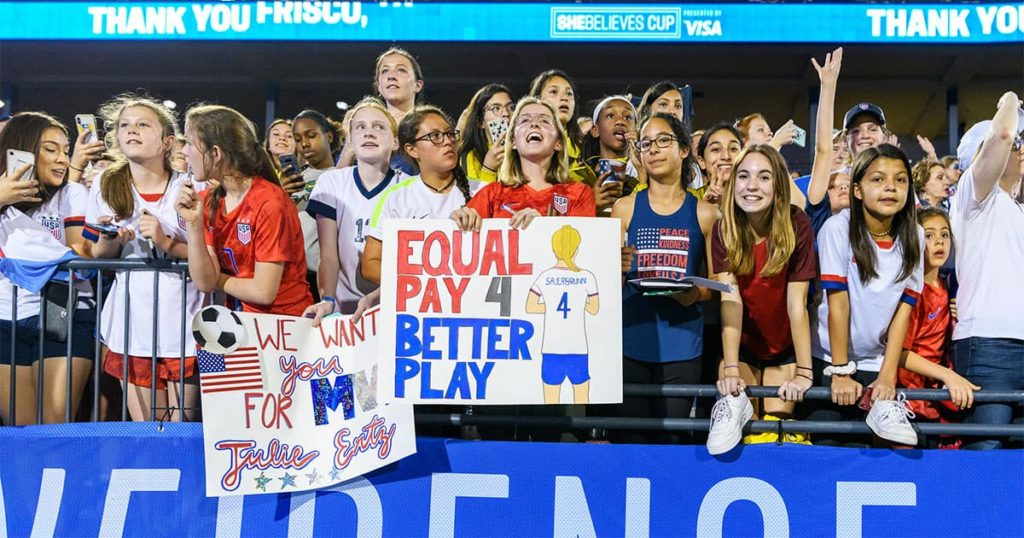 """Fans of the USWNT advocating for equal pay during a match. Pictured here"""""""
