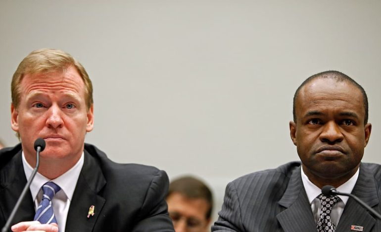 """NFL commissioner Roger Goodell and NFLPA executive director DeMaurice Smith sitting at a hearing. """"pictured here"""""""